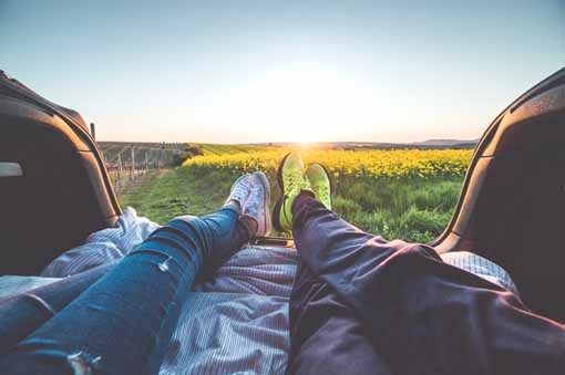 couple relaxing in car